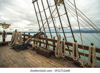 old sailing ship with strings and a mast or wooden ship or principal deck of a sailing ship