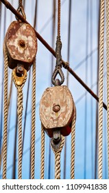 Old sailing ship wooden pulleys, selective focus, nautical background.