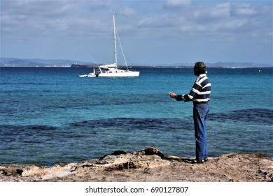 Old sailor watching the bay with white yachts,Formentera, peace, calm, serenity, harmony, fullness, well-being, nature, natural, contemplate, meditate, breathe, grow,