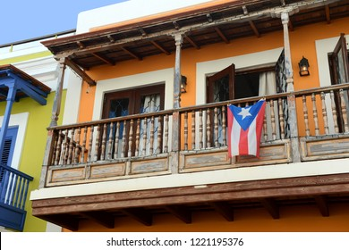 Old San Juan balcony in Puerto Rico with flag hanging