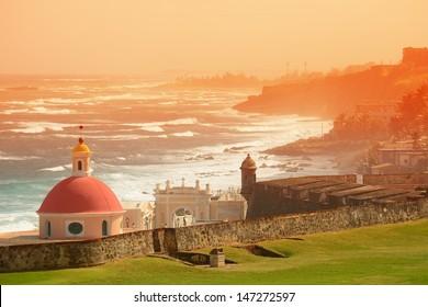 Old San Juan ocean view with buildings in red tone