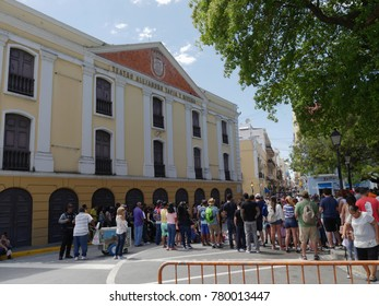 OLD SAN JUAN, PUERTO RICO—MARCH 2017: Crowds gather to watch a street performer outside the Teatro Alejandro Tapia Y Rivera at the old San Juan district in Puerto Rico.