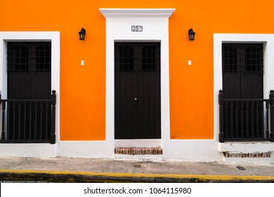Old San Juan, Puerto Rico - 09/04/2016: Bright pastel colour walls, a common building feature in Old San Juan (Puerto Rico)
