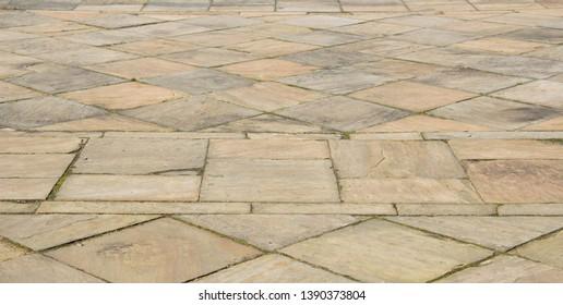 Old sandstone coloured flagstone background