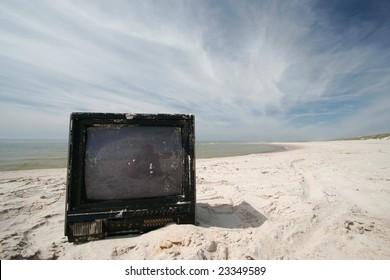 Old sandy tv on the beach