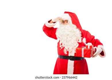 old santa claus with glasses and white gloves holding gifts in his hands, on white background