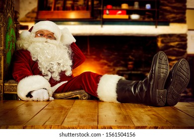 Re old Santa Claus in home interior and free space for your decoration.Fireplace and home interior.Chrsitmas time.