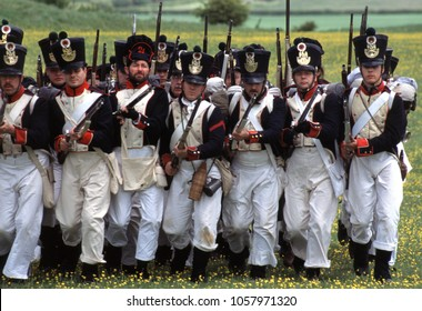 Old Sarum Salisbury Wiltshire UK 1996. A group of Napoleonic reenactors charge into battle dressed in period uniforms of Napoleonic French Fusiliers at a re-enactment of the Battle of Waterloo 1815.