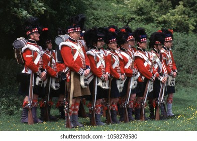 Old Sarum Wiltshire England 1995. A group of unidentified reenactors stand in line wearing the period uniforms of Scottish Highlanders at a re-enactment of the Battle of Waterloo 1815.