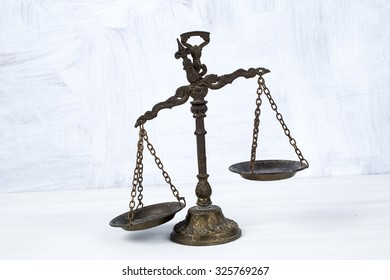 Old scale on a wooden table, justice and knowledge concept