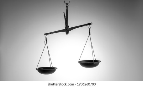 Old scales of justice on a bright background, black and white photography