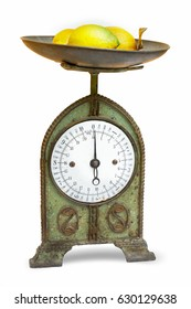 Old scales with lemons on  white background