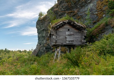 Old Scandinavian logger's wooden hut built on top of the wooden beams