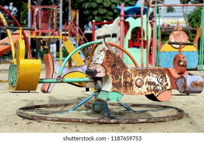 old scary dirty abandon playground on sand