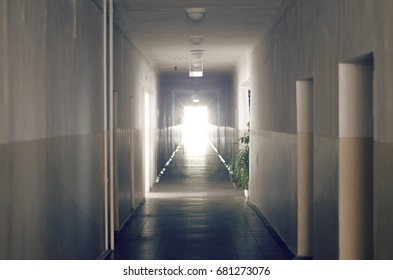 Old school corridor or hospital with window light in the end.