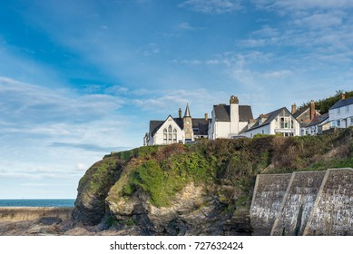 The old school house sits on a rocky outcrop overlooking the pretty fishing village and harbour at Port Isaac on Cornwall's Atlantic coast