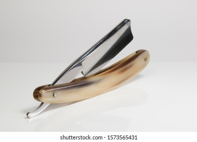 Old School Razor. Straight razor with horn scales and Spanish tip blade.
