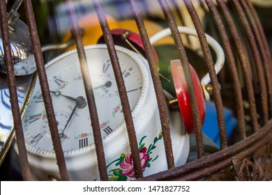 Old school retro vintage alarm clocks tracking lost time trapped in a bird cage rusty metal iron nice soft shadows slow dying feeling vibe historical objects hidden clock Prison locked away Chernobyl