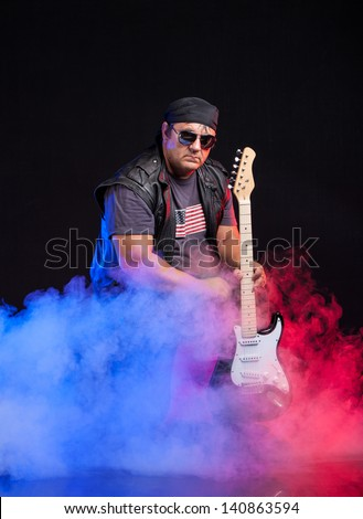 Old School Rock Musician Playing Electrical Stock Photo (Edit Now