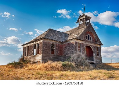 The old schoolhouse in the ghost town of Govan, Washington is rumored to be haunted by past murders.
