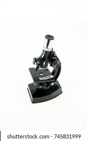 An old scientific microscope toy isolated on white