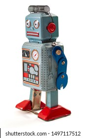 Old scifi vision of the future, science fiction nostalgia and vintage toy conceptual idea with retro blue metal robot isolated on white background with clipping path cutout