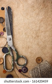 Old scissors and buttons on the paper