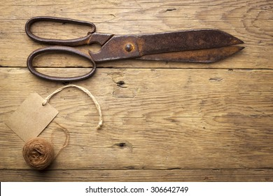 Old scissors on wood background