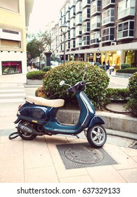 old scooter stands in street