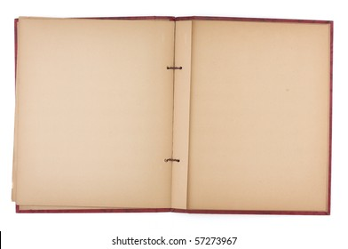 An old scrap book, open to reveal yellowing blank pages.