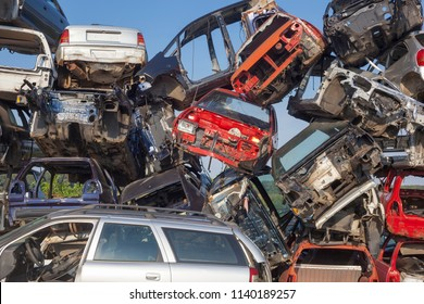 Old scrap cars on junkyard are waiting for recycling