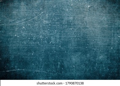 Old scraped blue wall, grungy background or texture