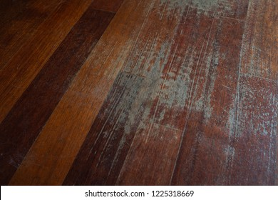 Old scratched surface of hardwood flooring in need of maintenance. parquet ruined by scratches made by prolonged use of chair.