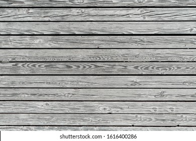 Old scratched wood texture gray board background