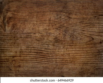 old scratched wooden oak board with cracks vintage background