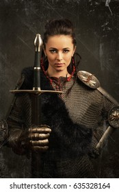 old scratches portrait of a medieval female knight in armour over grey background