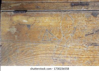 An old scribbled school desk