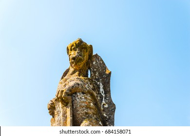 Old sculpture on the pedestal, beautifully preserved old artistic figure, decorative elements on the outside, vintage
