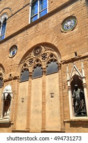 Old sculptures decorating niches of the Orsanmichele church in Florence, Tuscany, Italy