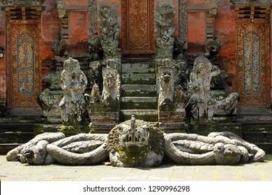 Old sculptures in Ubud Monkey Forest, Mandala Suci Wenara Wana, Ubud, Bali, Indonesia