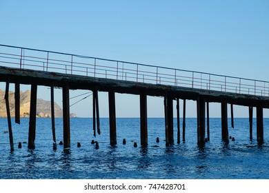 Old sea pier closeup. Transport, travel, nature