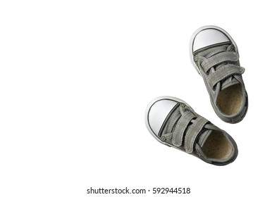 old secondhand black canvas shoes or sneakers for kids or baby and child foot on white background top view with copyspace isolated included clipping path