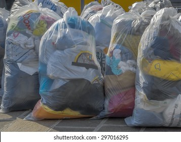 old second-hand clothes in plastic bags