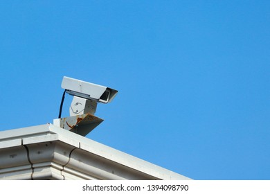 an old Security camera watching the safty for everyone fron high place at public park.