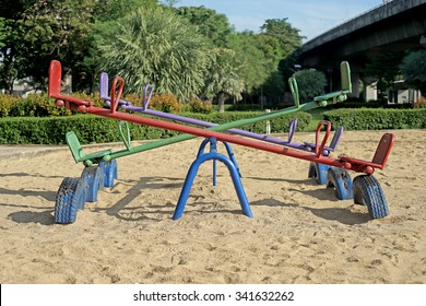 old seesaw or teeter-totter in kids playground
