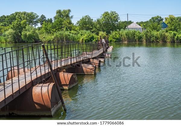 old-semisubmerged-pontoon-footbridge-ove