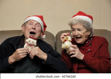 Old senior couple with santa hats celebrating christmas
