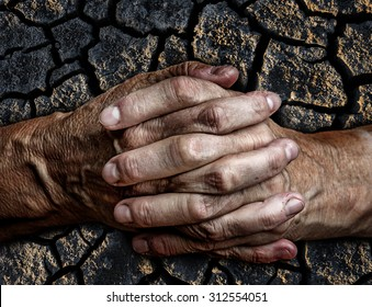 old senior hands and dry ground