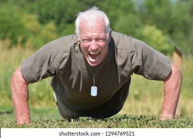 Old Senior Male Veteran And Bravery Exercising