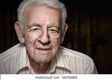 Old senior man closeup serious expression portrait